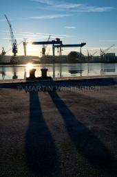 Werftkräne im Sonnenaufgang 3