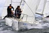 Kieler Woche 2013  J 24  - vorn: Dennis Frederiksen & Crew, hinten: Stefan Karsunke & Crew, BSC